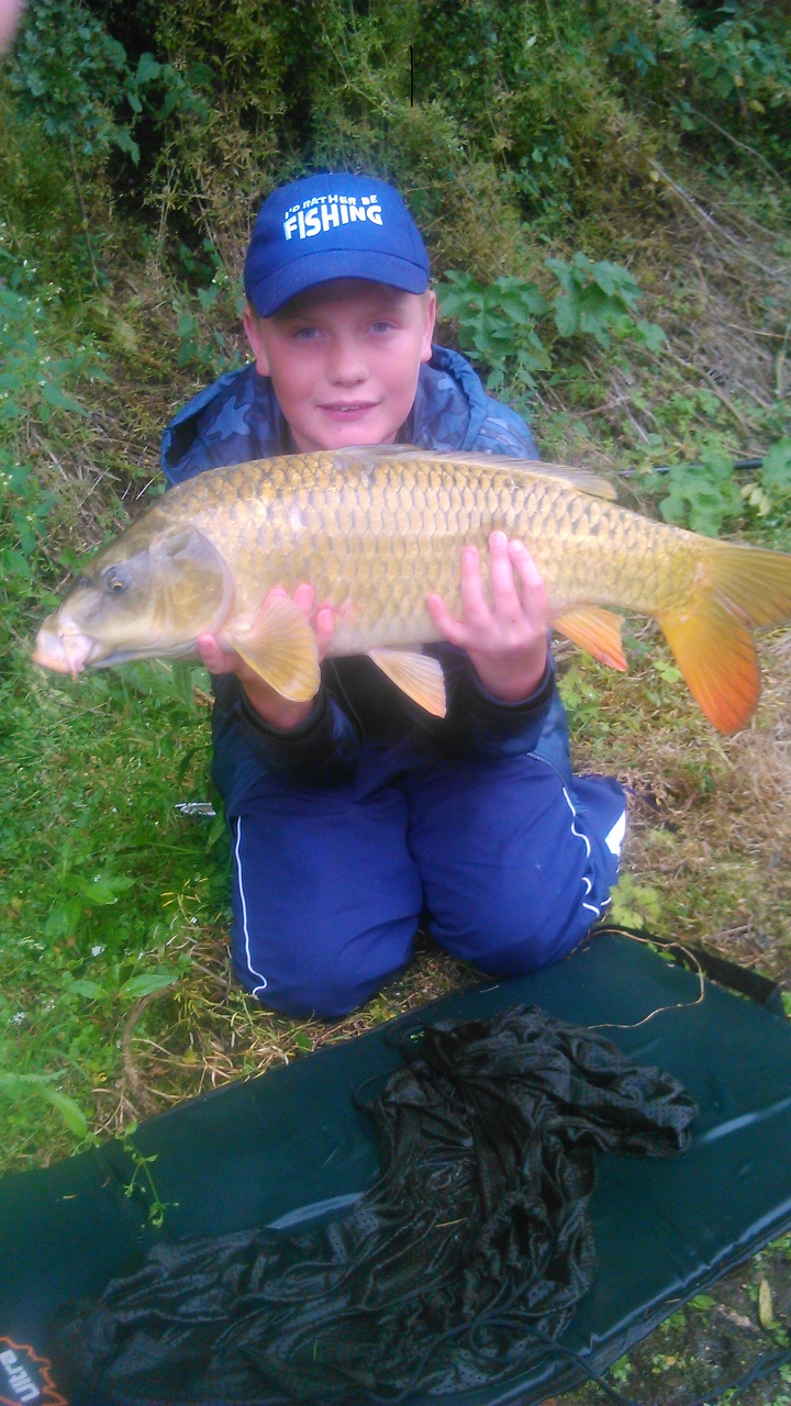Lewis Christy with 12lb 8 oz ghost carp caught on boilie