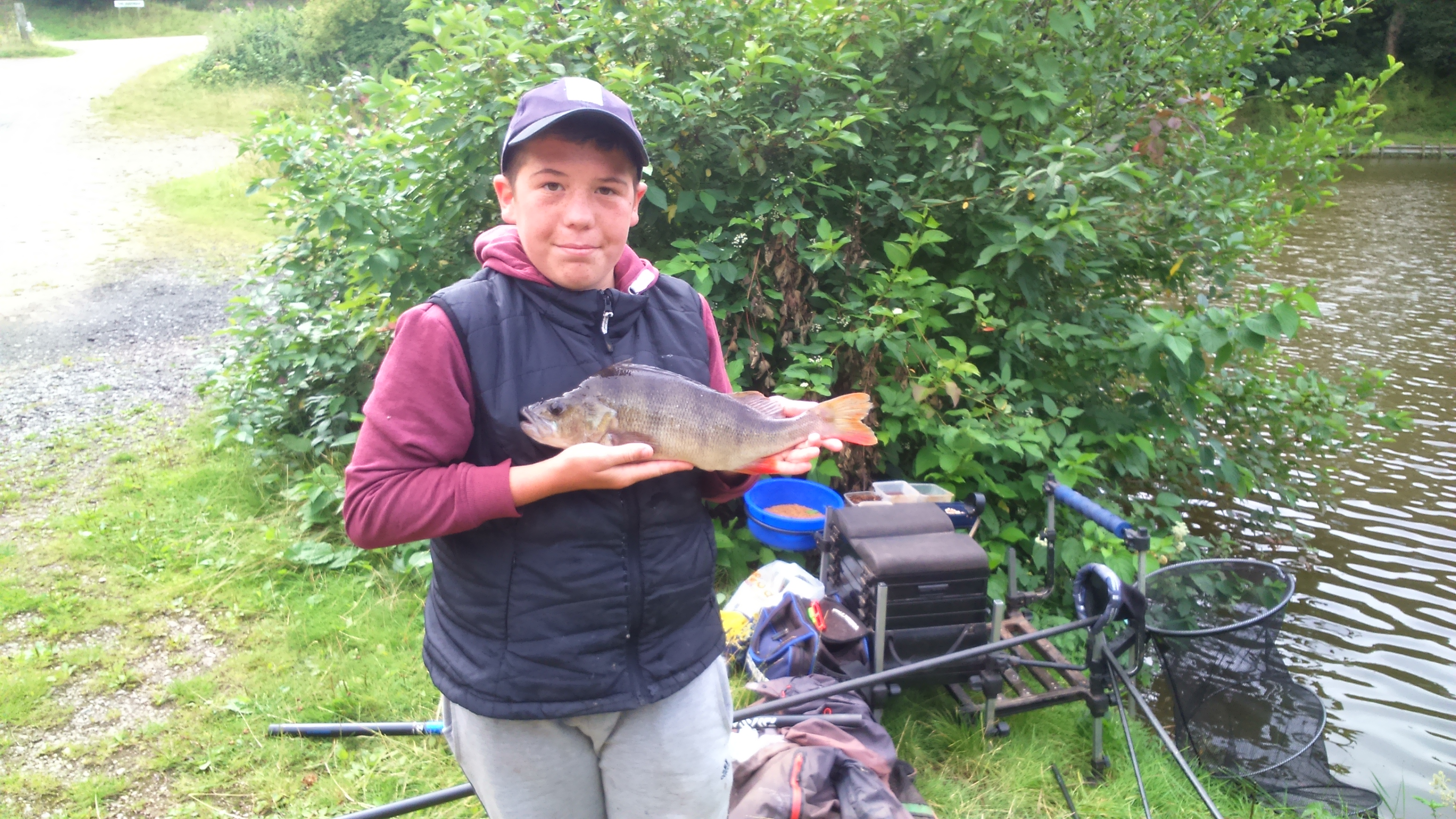 Liam with 3lb perch caught on pellet.