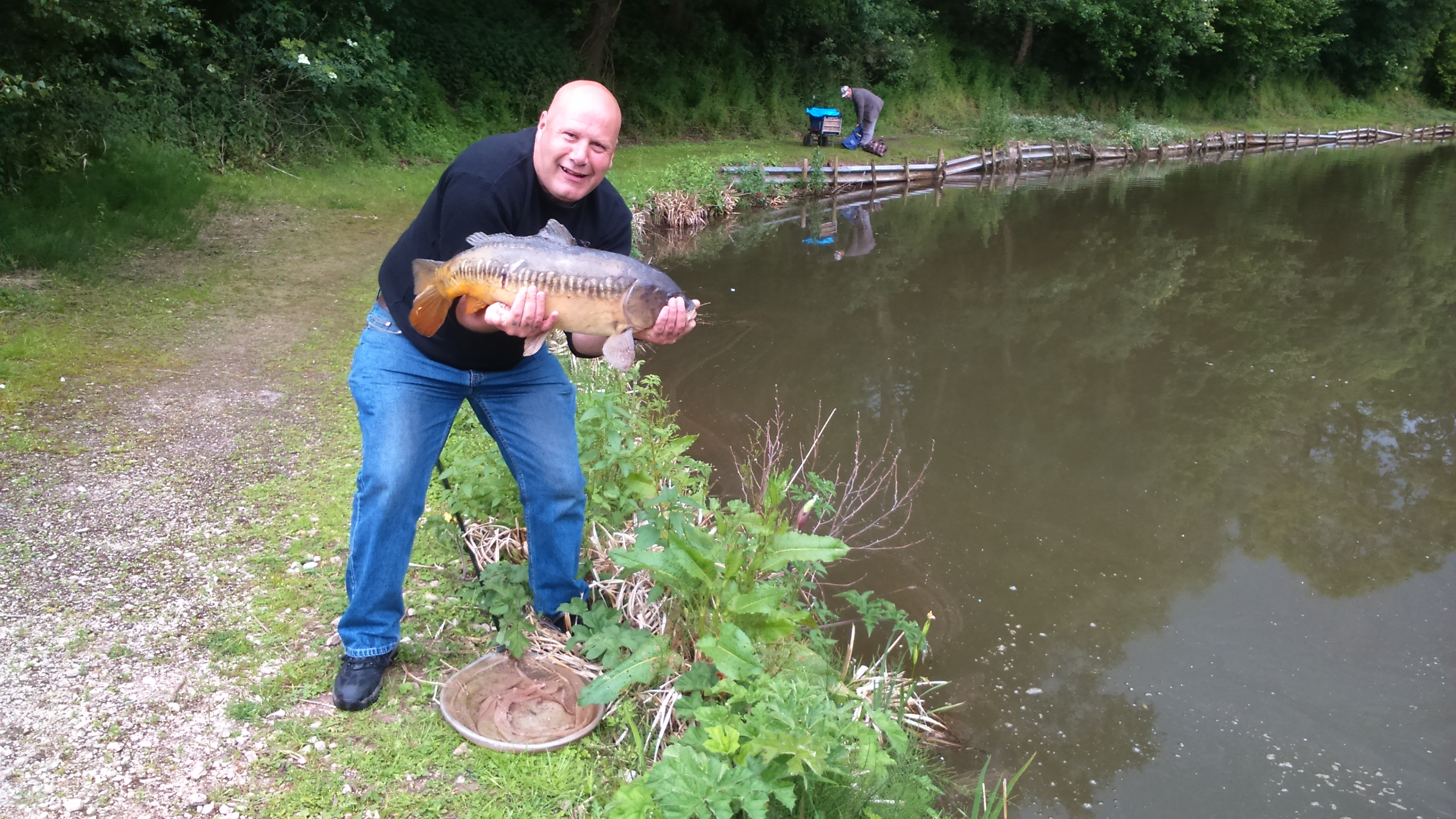 Nick with large mirror carp caught on bread flake
